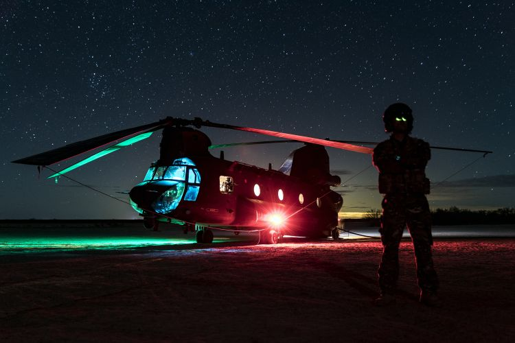 Royal Air Force CH-47 Chinook helicopter rests at night during a training mission in the Arizona desert. The chinook was being used at a FARP to refuel USMC helicopters CREDIT RAF