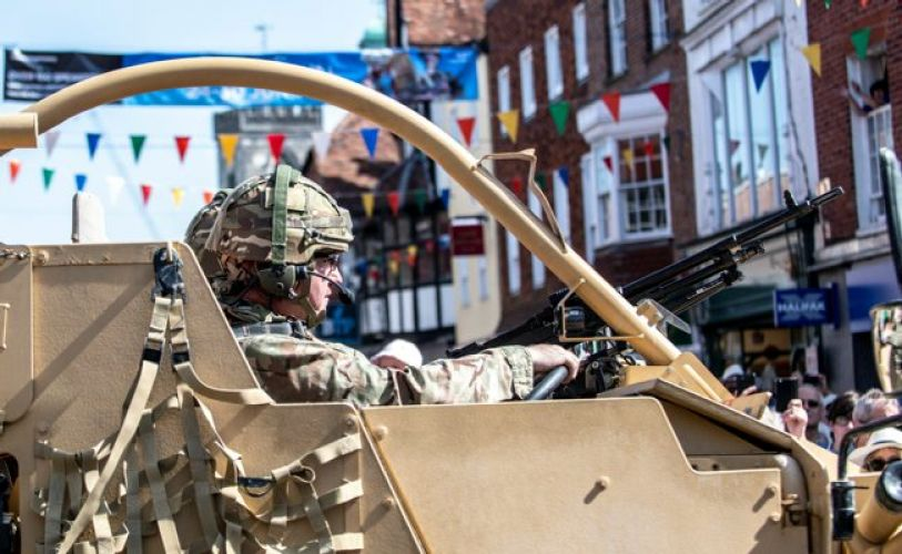 Soldier driving vehicle through Salisbury on Armed forces day