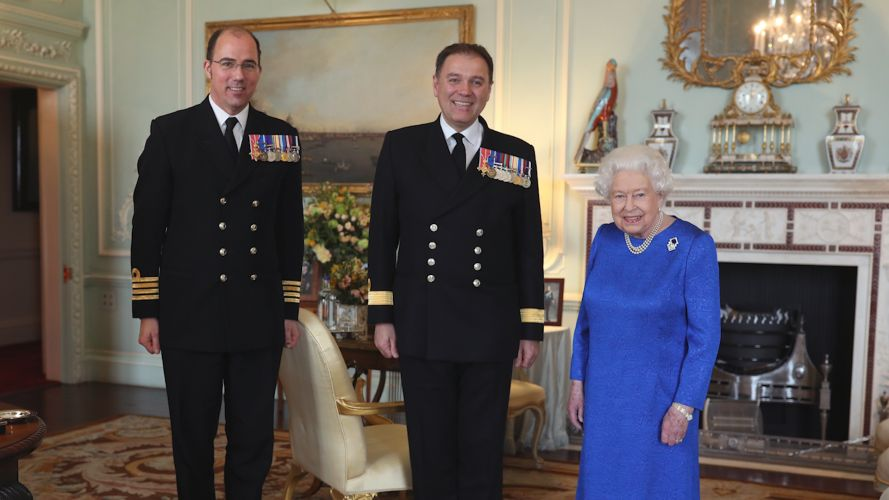 The Queen with Captain Angus Essenhigh, the captain of of HMS Queen Elizabeth (left) and Commodore Steven Moorhouse in March 2020 (Picture: PA).