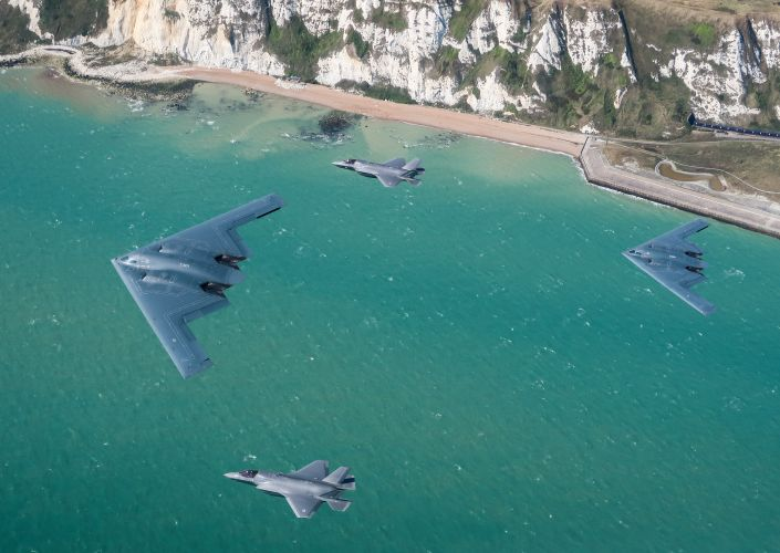 USAF B-2s fly over the English Channel with F-35Bs (Picture: MOD).