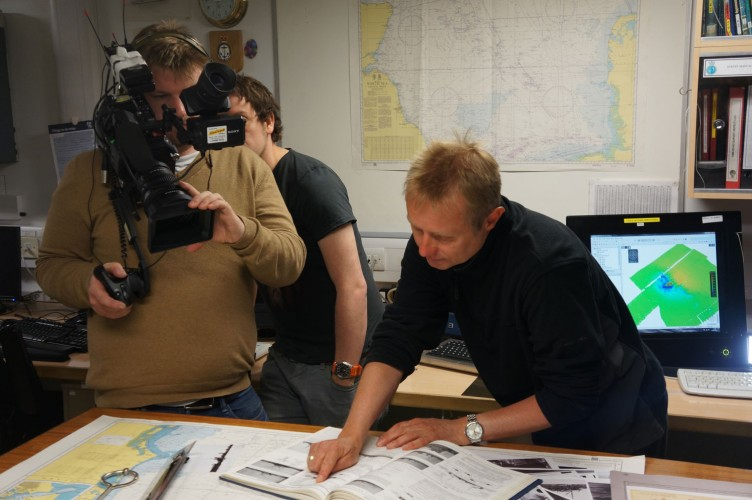 National Museum of the Royal Navy historian Nick Hewitt explaining the scans to an onboard BBC documentary team.