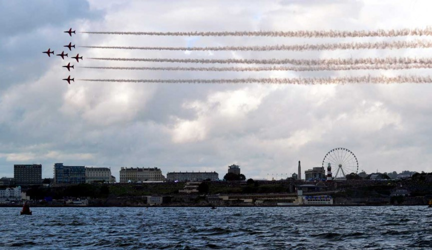 The Royal Air Force Acrobatic Team the Red Arrows, fly in formation over the Armed Forces Day National Event 2012 in Plymouth.