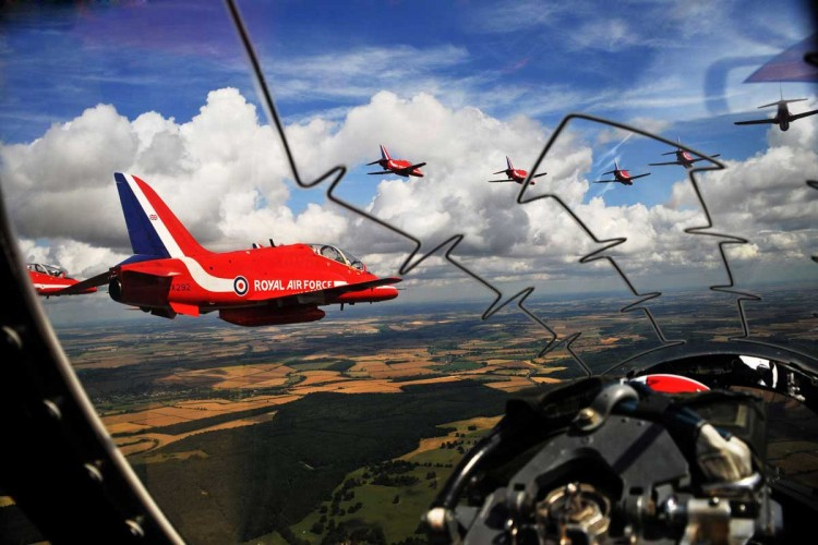 The Red Arrows are pictured flying over Scotland, taken from the cockpit of one of their aircraft.