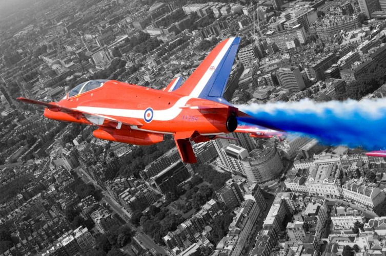 A Hawk T1A from the Red Arrows roars over London during a flypast for the Queen's 80th Birthday in 2006.