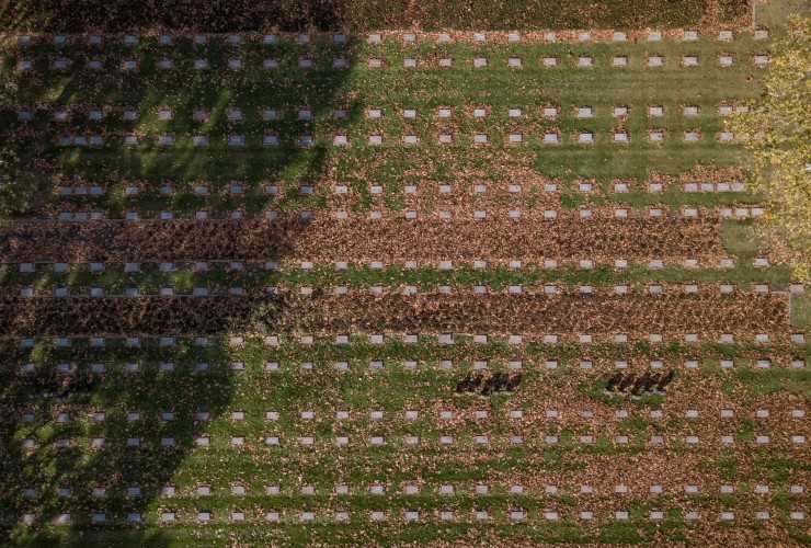 The images from 125ft up show the scale - with ranks of white grave markers on the Belgian countryside (Pictures: SWNS).