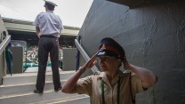 Private Richards adjusts her hat before going to her post on Centre Court