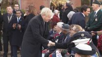 Boris Johnson shakes hands with veterans on Armistice Day in Wolverhampton.