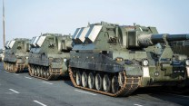 British Army Vehicles Await Loading For Estonia Deployment