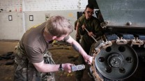 REME Mechanics Change Rubber Parts On An AS90 Track