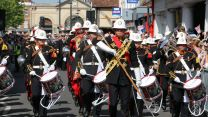 Military musicians parading through Salisbury Armed Forces Day