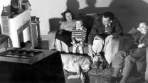 Family watching television in the 1950's