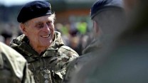 Prince Philip chats with soldiers from 1 Close Support Battalion, Royal Electrical and Mechanical Engineers  at Munster Barracks, Catterick, after returning from Operation Herrick in Afghanistan, May 2013.