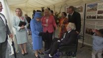The Queen speaks to a veteran at the opening of a new veterans village.