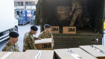 Members of 4 Regiment RLC deliver 40,000 surgical masks to St Thomas' Hospital in London (Picture: MOD).