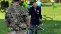Veteran Captain Tom Moore finishes walk that raised millions for NHS charities.