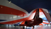 The new tail design to celebrate the Red Arrows display team 50th Anniversary lies under a huge Union Flag prior to its unveiling at RAF Scampton.