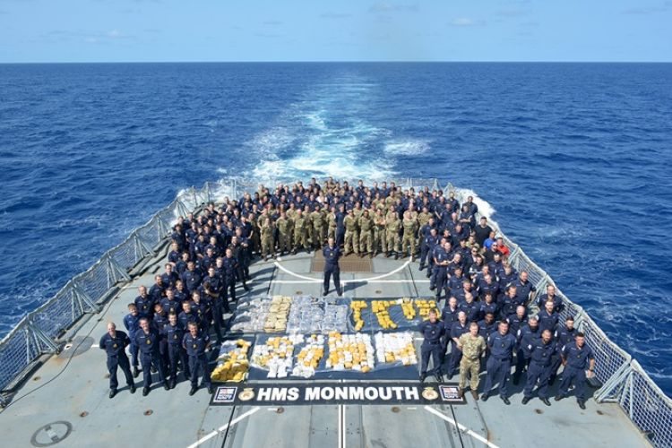 The Ship's Company of HMS Monmouth with the drugs haul (credit: Royal Navy).