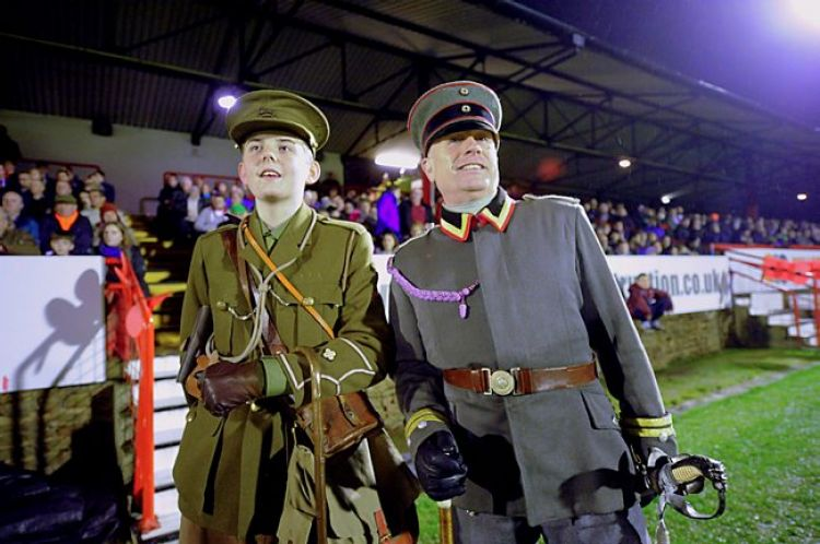 First World War re-enactors at a modern football game honouring the memory of the 1914 Christmas Truce