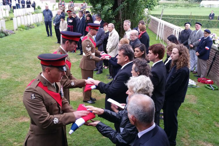 23rd Battalion present Union Flags at burial service for WWI soldiers in France