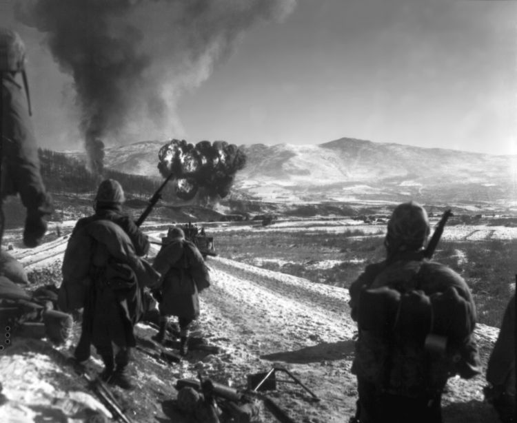 26 December 1950 US Marines move forward after air support hits the enemy in the hills