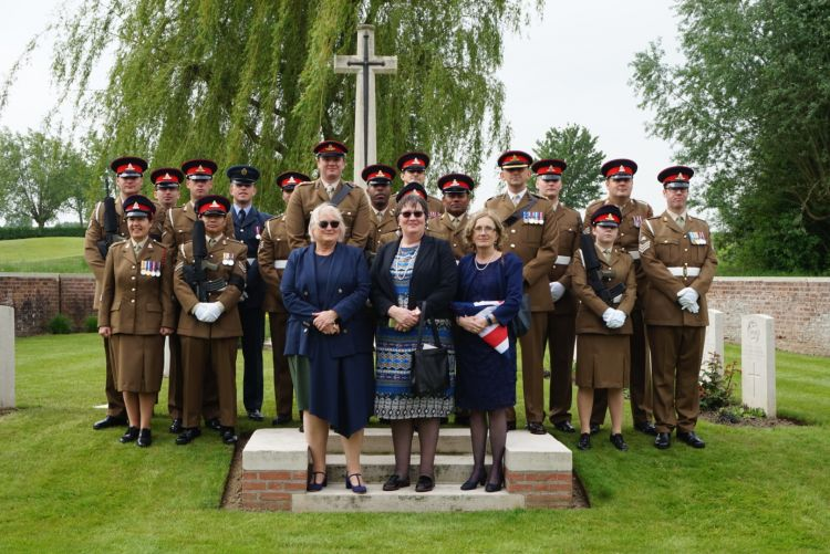2nd Lt. Henderson's great nieces (l to r) Judith Leyman, Sarah Foot and Lucy Cocup stand with the Royal Artillery Regiment and military representatives (Crown Copyright)