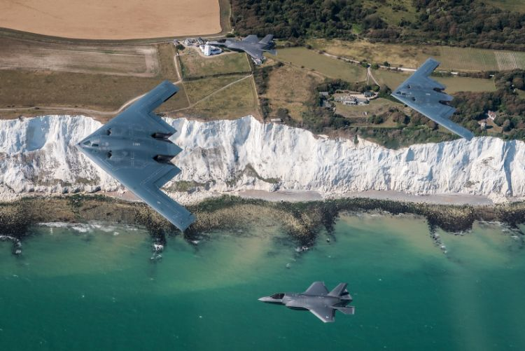 two UK F-35 Lightning jets (above and below), seen here flying in formation with two B-2 Spirit stealth bombers of the United States Air Force, as part of their deployment to RAF Fairford in Gloucestershire, UK.