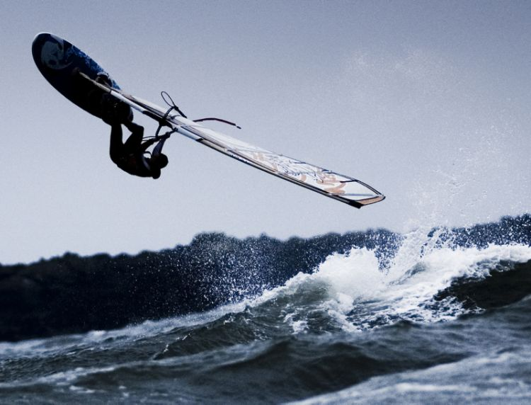 A Royal Air Force windsurfer flips over after hitting a wave during the Forces Open Wave Windsurfing Championships Rhosniegr. Credit: Corporal Paul Oldfield, RAF Crown Copyright