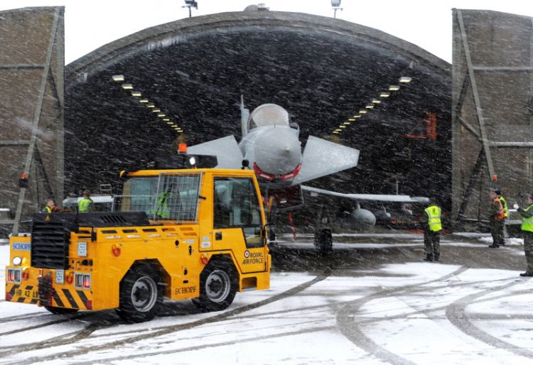 A Typhoon jet is towed from its hangar aka 'shed' at RAF Coningsby. Credit: Corporal Andrew Seaward, Crown Copyright