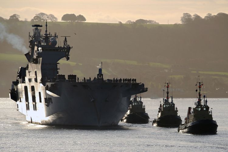 HMS Ocean returns to Plymouth Sound from an eight month deployment off Libya.
