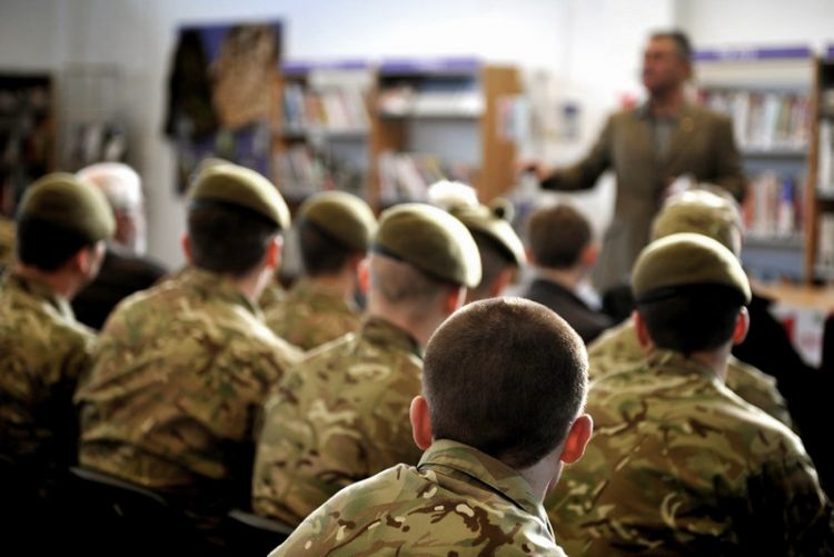Ex-soldier Andy McNabb talks to service personnel about the importance of literacy and education. Credit: Crown Copyright