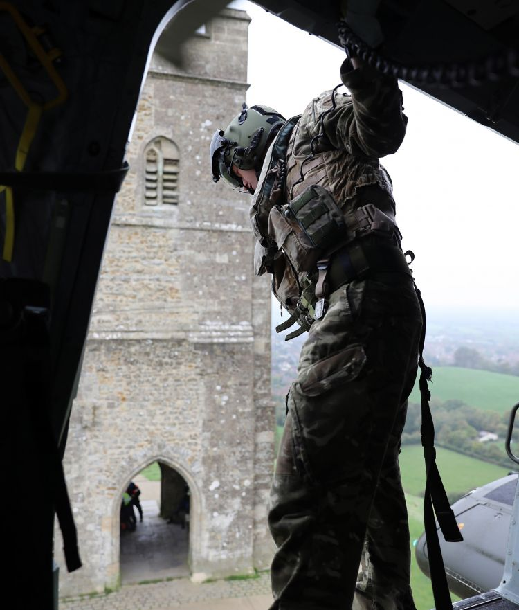 NAS Aircrewman Guides the Merlin to the Drop-Off Point