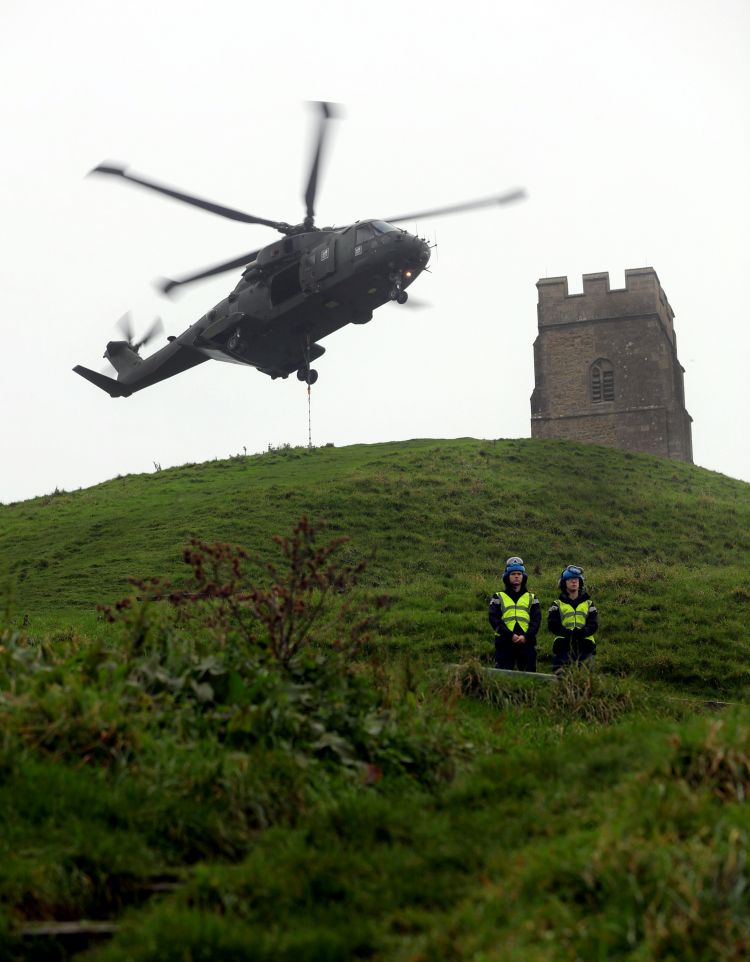 846 NAS Engineer Personnel Stop Eager Onlookers From Entering The Danger Area
