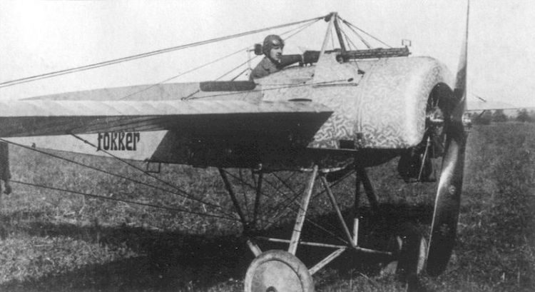 A pilot sitting in a Fokker Eindecker EII, fitted with his new synchronisation device