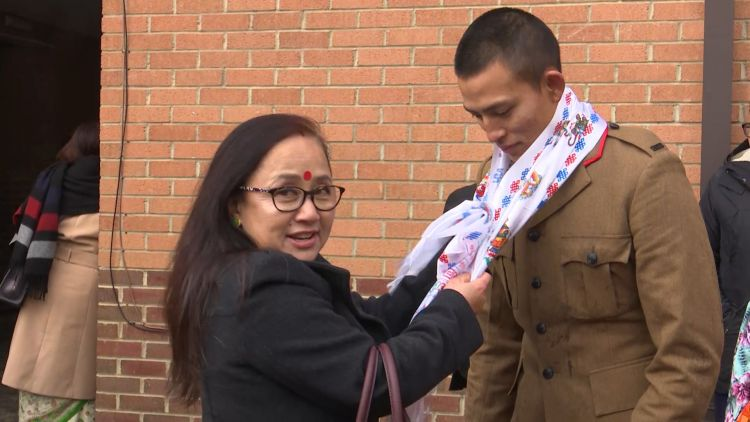 A Gurkha recruit celebrates passing out with a family member 151119 CREDIT BFBS