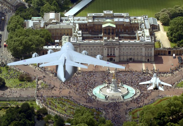 A RAF Tornado aircraft (right) escorts a giant C17 Globemaster above Buckingham Palace for Queen's birthday 140608 CREDIT MOD