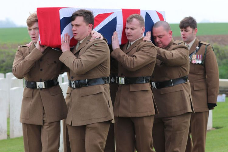 A bearer party from 1 RIFLES carry Private Burt's coffin 150419 CREDIT Crown Copyright.jpg