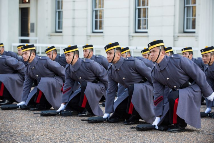 Gurkhas grounding their arms prior to presenting their Kukri's at Wellington Barracks in London.