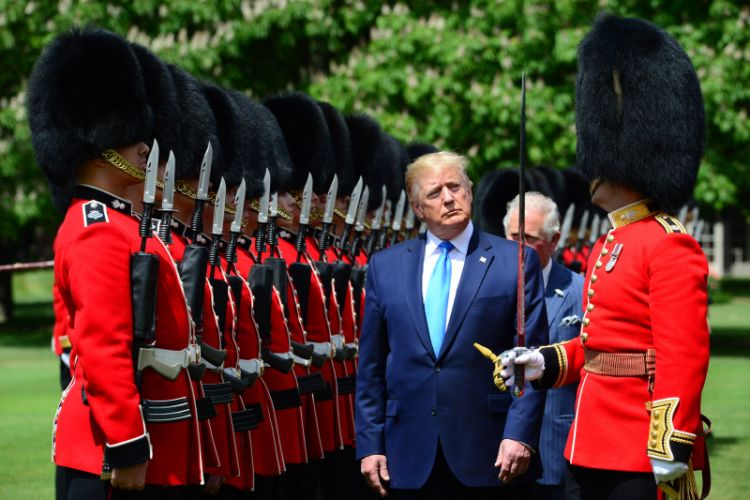 President of the United States Donald Trump, His Royal Highness Prince Charles and Captain of the Guard Major Hamish Hardy (right), inspect the Guard of Honour at Buckingham Palace.
