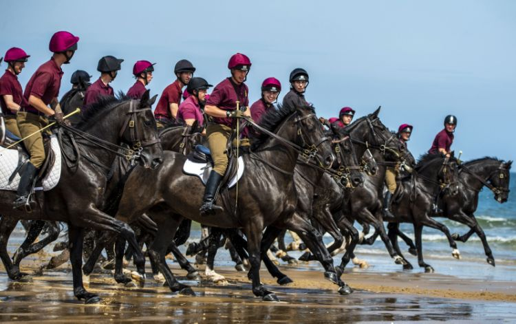 Members of The Army's Household Cavalry Mounted Regiment (HCMR), seen here riding at Holkham beach in Norfolk.
