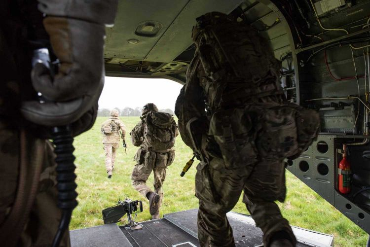 Paratroopers from 2nd Battalion The Parachute Regiment are transported by RAF Chinook helicopter on Exercise Joint Warrior