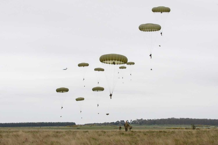 Soldiers from 2 PARA Battlegroup jump near the ground at the culmination of Exercise Joint Warrior from a C130 Aircraft, from Wattisham