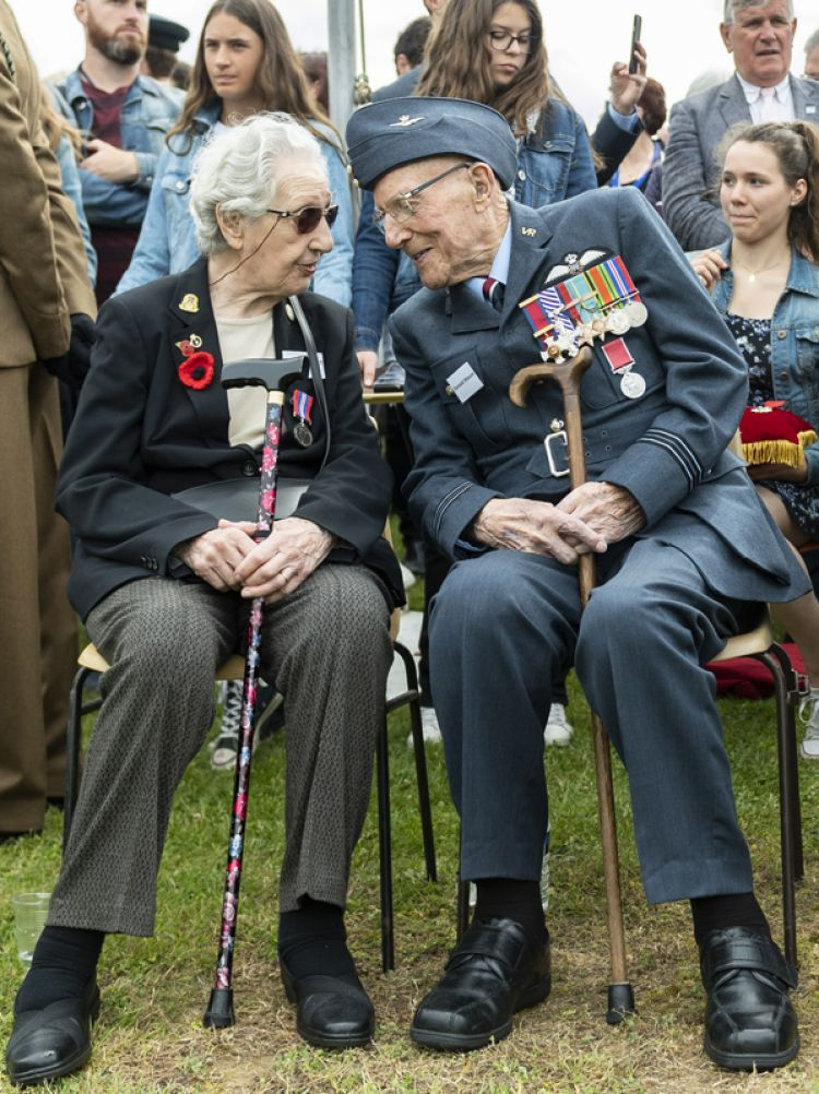 two RAF veterans, sharing their memories at an event paying tribute to those who secured Pegasus Bridge in France 75 years ago.