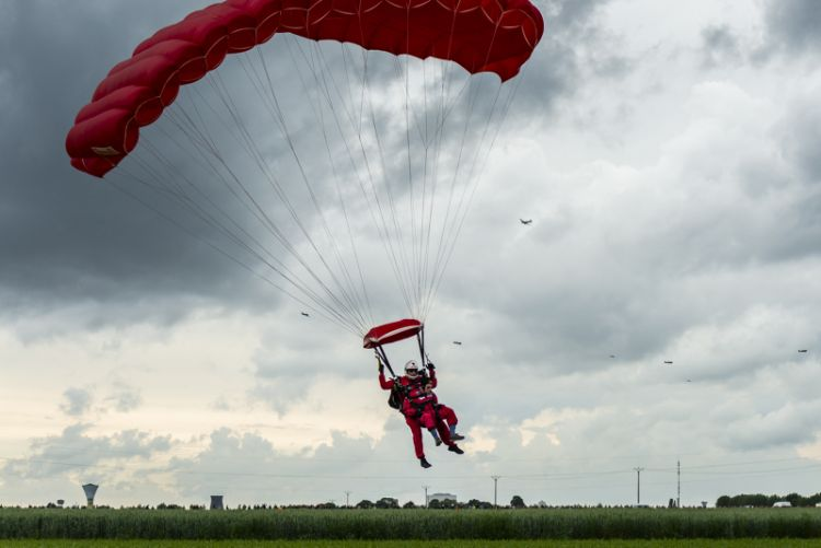 D-Day veteran Harry Read 95yrs, tandem parachuting into Sannerville, France.