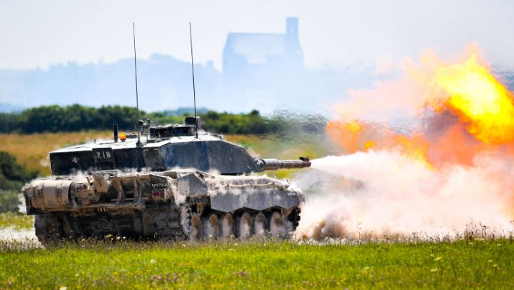 A Challenger 2 Main Battle Tank, firing its main armament at targets in the distance in South Wales.