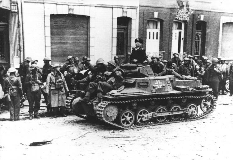 After the capture of Calais by fascist German troops, wounded British soldiers are brought out from the old town by German tanks