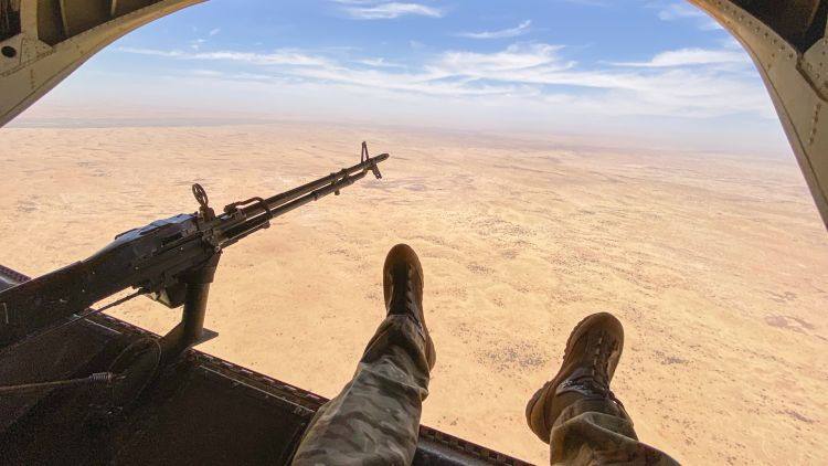 Anonymous UK service personnel legs and gun out of Chinook in Mali Sahel Africa - pic used on 120620 CREDIT MOD