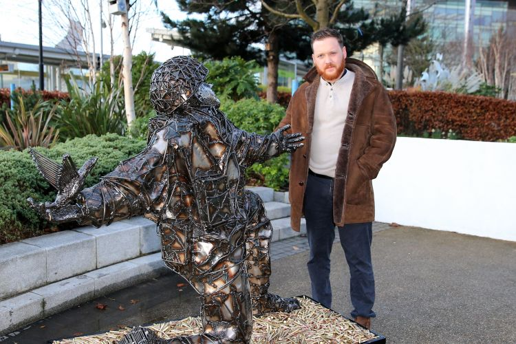Artist Alfie Bradley with D-Day Soldiers of Sacrifice statue (Picture: The D-Day Story museum).