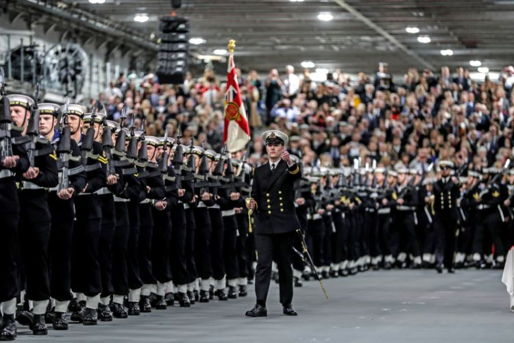 the ships company (HMS Prince of Wales), seen here on parade for the ships commissioning into the Fleet, at HM Naval Base Portsmouth.
