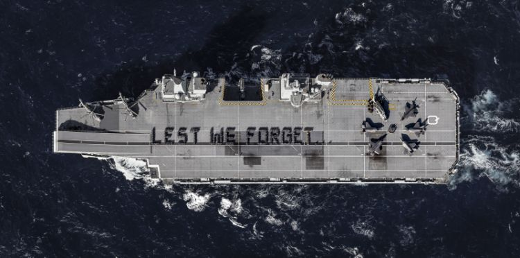 Image spelling out 'Lest We Forget' on the 4 acre flight deck of HMS Queen Elizabeth, includes a poppy formed around UK F-35B Lightning jets which are conducting operational trials onboard, ahead of the ship's first operational deployment in 2021.
