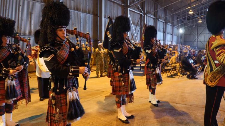 Bagpipe players inside Nicosia abandoned airport 040319 CREDIT BFBS